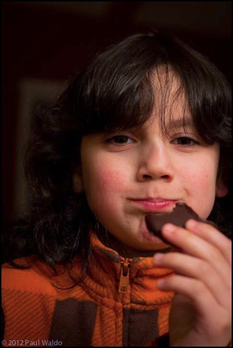 Photo of Devon eating a healthier version of a Thin Mint cookie
