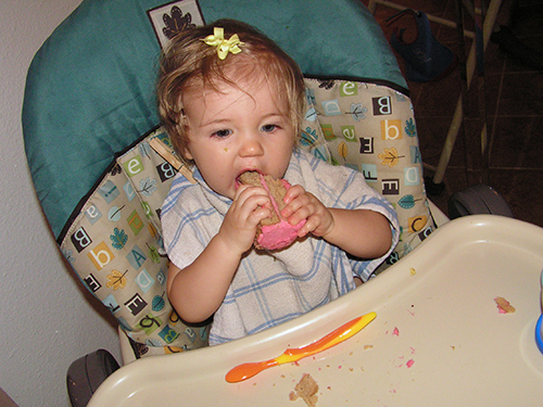 Fiona eating her first birthday cake