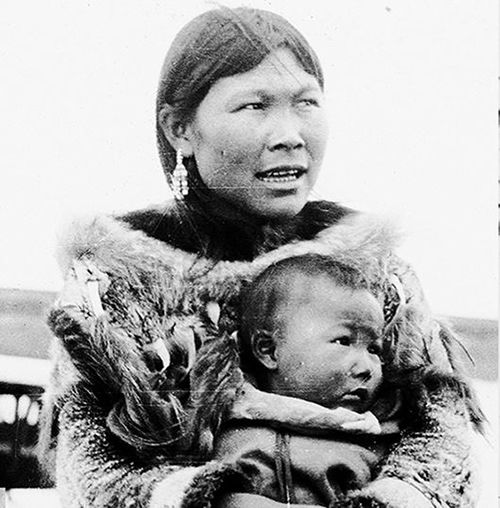 Eskimo woman holding her baby