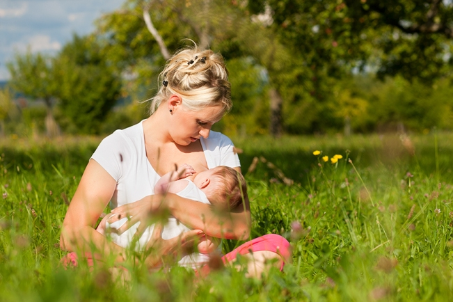 Breastfeeding in a field of grass