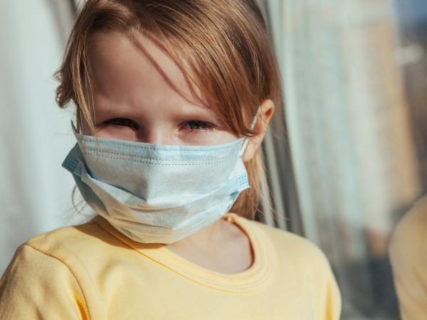 A little girl in a medical mask. Coronavirus quarantine